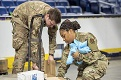 Louisiana Air National Guardsmen sort medical supplies at Smoothie King Center in New Orleans, March 31, 2020, while supporting COVID-19 response efforts. Medical supplies were stored at the sports arena before being distributed to drive-thru community-based COVID-19 testing sites. (Photo By: Air Force Senior Master Sgt. Dan Farrell)
